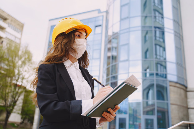 female-architect-with-construction-site_1157-36105