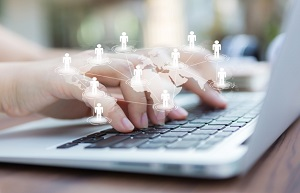 hands-with-laptop-virtual-world-map_1232-876