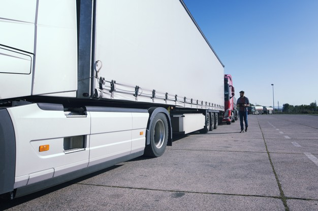 truck-driver-inspecting-truck-long-vehicle-before-driving_342744-1311