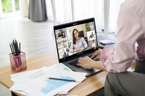 young-woman-is-working-with-her-computer-screen-while-business-meeting-through-video-conferencing-application_33799-8741